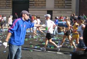"""Boston marathon mile 25 gatorade volunteer 050418"". Licensed under CC BY-SA 2.0 via Commons - https://commons.wikimedia.org/wiki/File:Boston_marathon_mile_25_gatorade_volunteer_050418.jpg#/media/File:Boston_marathon_mile_25_gatorade_volunteer_050418.jpg"