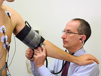 dr accad measuring blood pressure